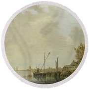 A River Scene With Distant Windmills Round Beach Towel