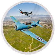 A T-6 Texan And P-51d Mustang In Flight Round Beach Towel