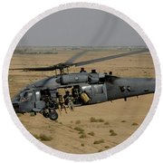 A U.s. Air Force Hh-60 Pavehawk Flies Round Beach Towel
