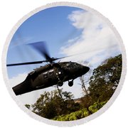 A U.s. Army Uh-60 Black Hawk Helicopter Round Beach Towel