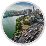 Aerial View Of The Austin Skyline As Rush Hour Traffic Picks Up On I-35 Round Beach Towel