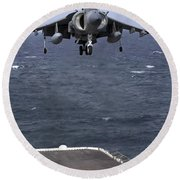 An Av-8b Harrier II Prepares To Land Round Beach Towel