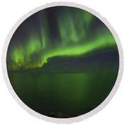 Aurora Borealis Over Iceland Shoreline Round Beach Towel