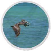 Beautiful Pelican In Flight Over The Water In Aruba Round Beach Towel