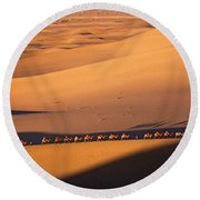 Camel Caravan Crosses The Dunes Round Beach Towel