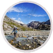 Crossing A River In Patagonia Round Beach Towel