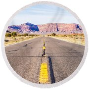 descending into Monument Valley at Utah  Arizona border  Round Beach Towel