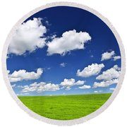 Green Rolling Hills Under Blue Sky Round Beach Towel