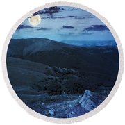 Light On Stone Mountain Slope With Forest At Night Round Beach Towel