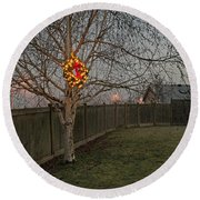 Lit Christmas Wreath Hanging In Tree Round Beach Towel