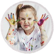 Little Girl Covered In Paint Making Funny Faces. Round Beach Towel