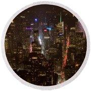 Midtown Manhattan Skyline Aerial At Night Round Beach Towel