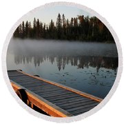Morning Mist Over Lynx Lake In Northern Saskatchewan Round Beach Towel