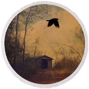 Lone Crow Flies Over The Old Country Road  Round Beach Towel