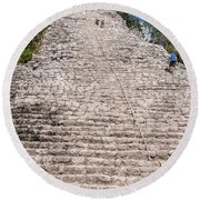 People Climbing Nohoch Mul At The Coba Ruins  Round Beach Towel