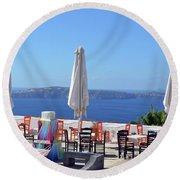 Restaurant By The Aegean Sea  In Santorini, Greece  Round Beach Towel
