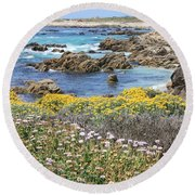 Rocky Surf With Wildflowers Round Beach Towel