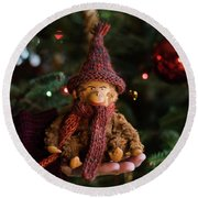 Silly Old Monkey Toy In A Child Hands Under The Christmas Tree Round Beach Towel