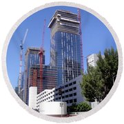 skyscraper construction in Downtown Los Angeles... Round Beach Towel