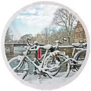 snowy Amsterdam in the Netherlands Round Beach Towel