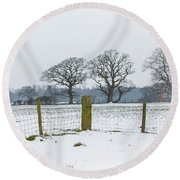 Standing In The Snow Round Beach Towel
