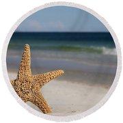 Starfish Standing On The Beach Round Beach Towel