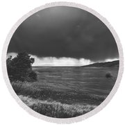 Storm Brewing Over The Mud Flats Round Beach Towel