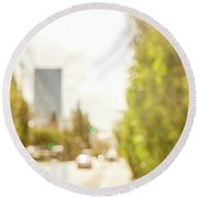 The Hedge By The Sidewalk During Day In The City Of Los Angeles Round Beach Towel