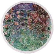 The House Among The Roses Round Beach Towel
