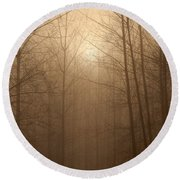 Trees Silhouetted In Fog Round Beach Towel