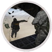 U.s. Airmen Jump From A C-130 Hercules Round Beach Towel