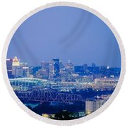 Buildings In A City Lit Up At Dusk Round Beach Towel