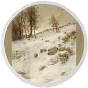 A Flock Of Sheep In A Snowstorm Round Beach Towel