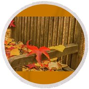 A Foliage Pillow On A Bench In A Woodland Round Beach Towel