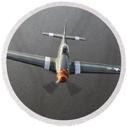 A North American P-51 Mustang In Flight Round Beach Towel