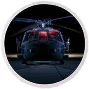 A Uh-60 Black Hawk Helicopter Lit Round Beach Towel