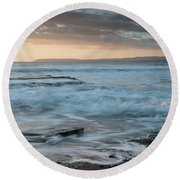Beautiful Dramatic Sunset Over A Rocky Coast Round Beach Towel