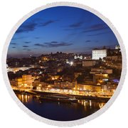 City Of Porto In Portugal By Night Round Beach Towel
