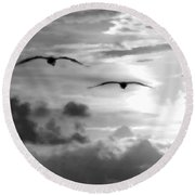 2 Pelicans Flying Into The Clouds Round Beach Towel