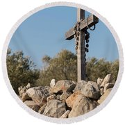 Rosary Hanging On A Small Wooden Cross On A Stone Wall Round Beach Towel