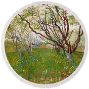 The Flowering Orchard Round Beach Towel