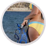 Woman Getting Ready To Go Snorkeling Round Beach Towel