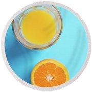 Glass Of Orange Juice And Half Of Orange Round Beach Towel
