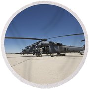 Hh-60g Pave Hawk With Pararescuemen Round Beach Towel