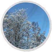Snowy Trees Against A Blue Sky Round Beach Towel