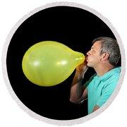 Man Inflating Balloon Round Beach Towel