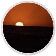 Sun Sinking Into Pacific Ocean Round Beach Towel