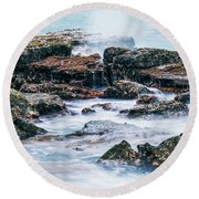 Rocks And Waves At Point Cartwright  Round Beach Towel