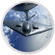 A B-2 Spirit Moves Into Position Round Beach Towel by Stocktrek Images