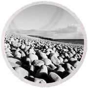 A Beach Of Stones Round Beach Towel